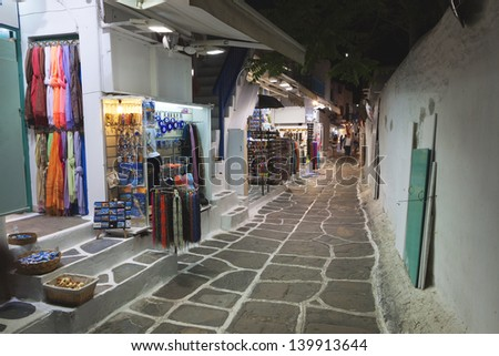 Streets of Mykonos by night at the Cyclades islands in Greece - stock photo