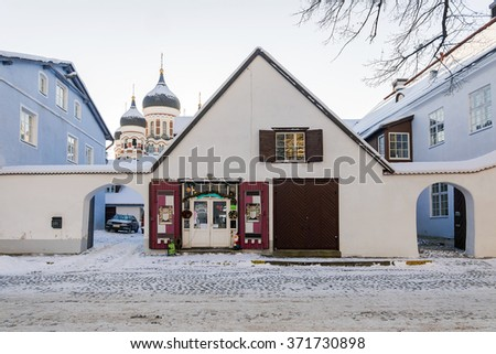 streets of old Tallinn in the winter on a background of the Alexander Nevsky Cathedral, Estonia - stock photo