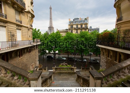Streets of Paris with Eiffel Tower in background - stock photo