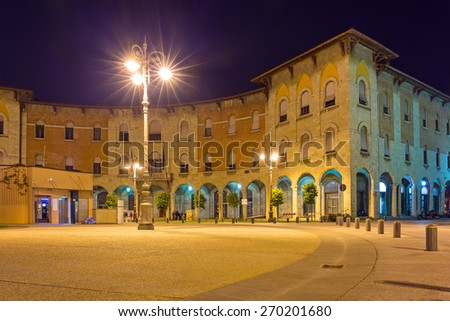 Streets of Pisa at night with traditional architecture, Italy - stock photo