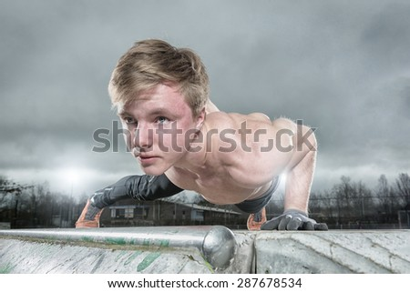 Streetworkout in front of grey sky - stock photo