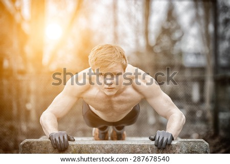 Streetworkout with sunset - stock photo
