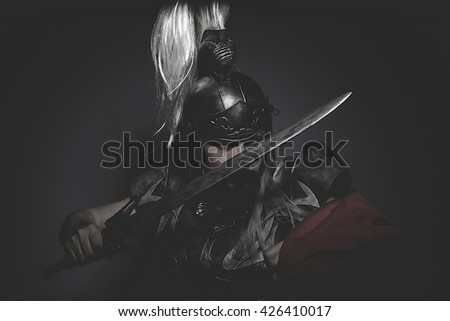 Strengh warrior helmet, armor and red cape on a battlefield, conflict and struggle in the Roman Empire