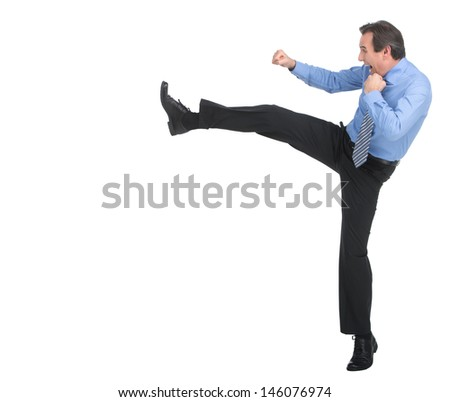 Strength and authority. Full length of angry businessman imitating a fight standing against white background - stock photo