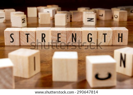 STRENGTH word written on wood block - stock photo