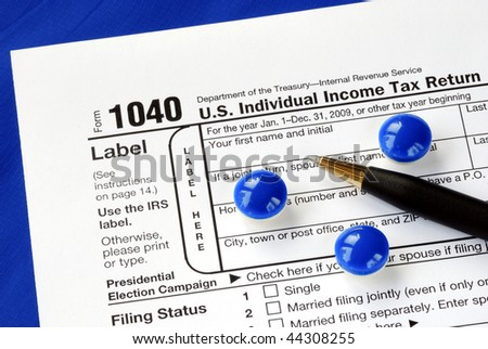 Stress and headache in filing the income tax return - stock photo