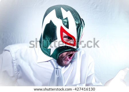 Stress, angry businessman with Mexican wrestler mask, expressions of anger and rage - stock photo