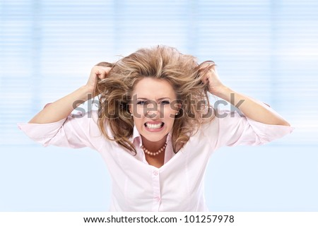Stress / Angry woman pulling her hair in a frustration - stock photo