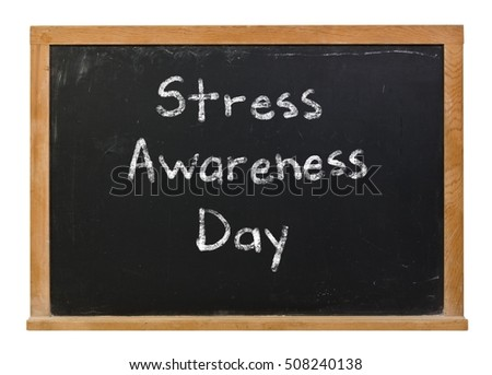 Stress Awareness Day written in white chalk on a black chalkboard isolated on white