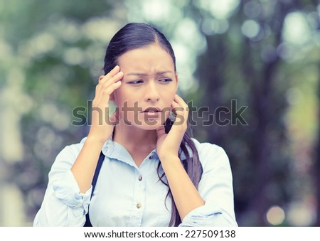 Stress. Closeup portrait unhappy business woman hands on head bothered by mistake having bad headache isolated outside outdoors background with park trees. Negative human emotion facial expression - stock photo
