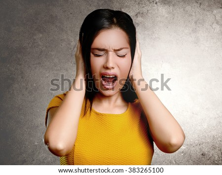 Stress concept - angry woman screaming in pain - stock photo