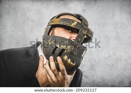 stress, dangerous business man with iron mask and expressions