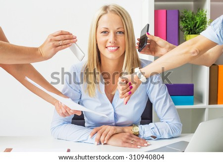 Stress free business woman in the office - stock photo
