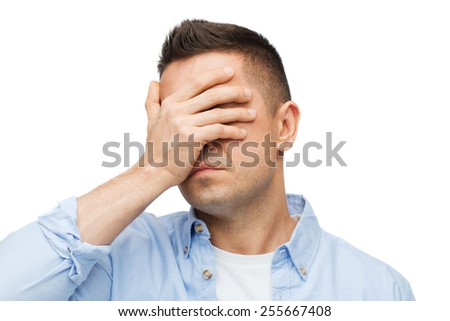 stress, headache, health care and people concept - unhappy man covering his eyes by hand - stock photo