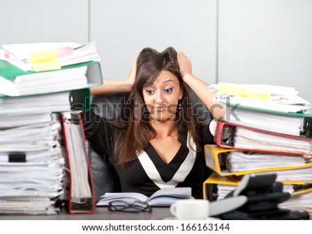 Stress on work.woman holding her head - stock photo
