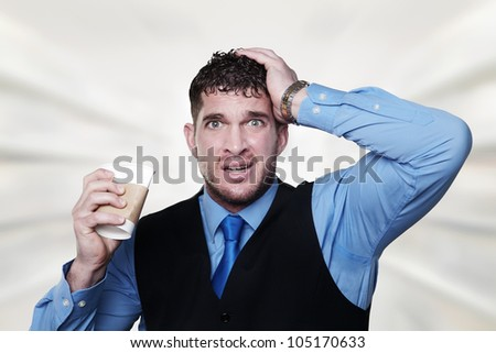 stress out business man pulling at his hair and squashing a paper coffee cup