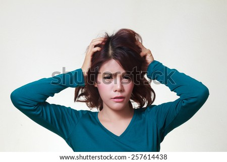 Stress. Woman stressed is going crazy pulling her hair in frustration.  - stock photo