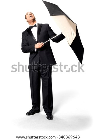 Stressed African man with short black hair in evening outfit using umbrella - Isolated