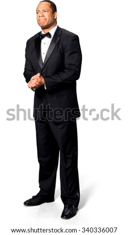 Stressed African man with short black hair in evening outfit with clasped hands - Isolated