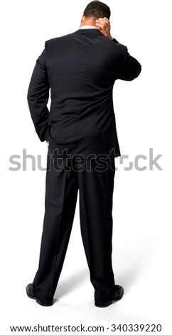 Stressed African man with short black hair in evening outfit with hands in pockets - Isolated