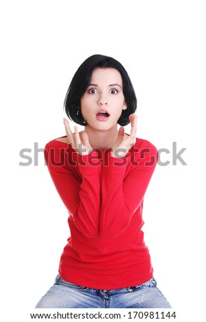 Stressed and shocked woman is going crazy in frustration.  - stock photo