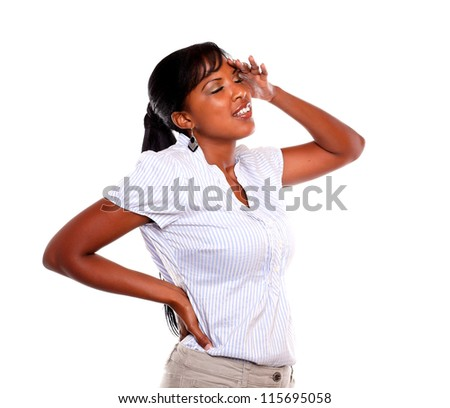 Stressed and tired young woman with headache against white background - stock photo