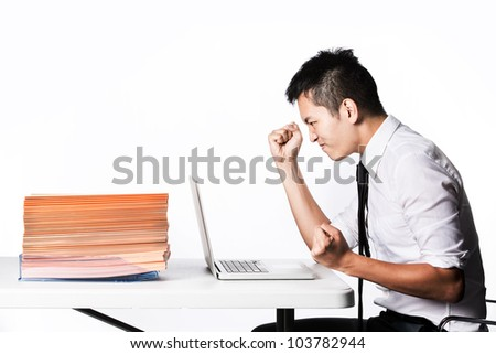 Stressed Asian Business man due to the of amount of work he has to do. - stock photo