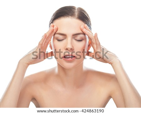 stressed beautiful young woman with healthy face and clean skin having headache isolated on white background  - stock photo