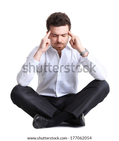 Stressed business man with a headache  - stock photo