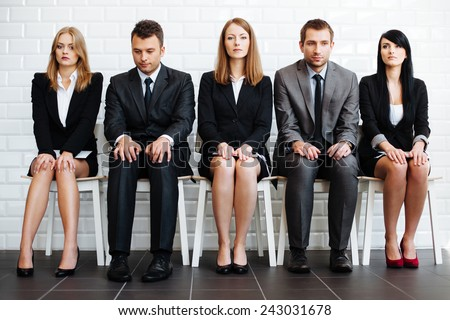 Stressed business people wiating for job interview