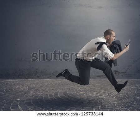 Stressed business running with tablet - stock photo