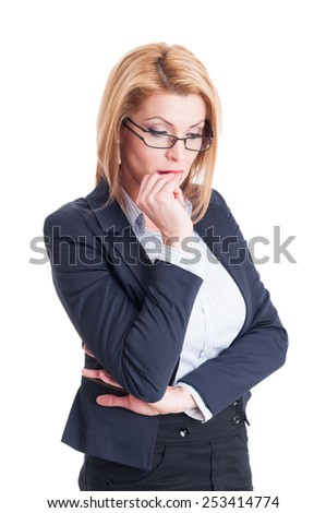 Stressed business woman bitting her nails and thinking - stock photo