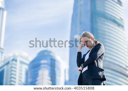 Stressed business woman in the city. - stock photo