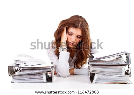 Stressed business woman working at her office - stock photo