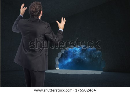 Stressed businessman gesturing against cloud door in dark room