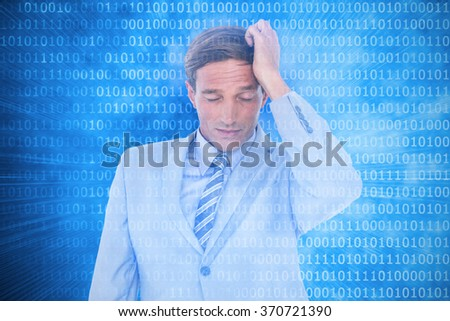 Stressed businessman getting a headache against glowing futuristic binary code - stock photo