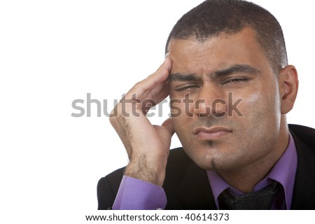 Stressed Businessman holding his temple. Isolated on white. - stock photo