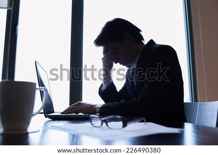 Stressed businessman in the office - stock photo