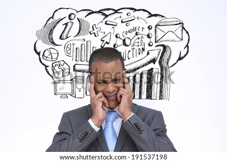 Stressed businessman putting his fingers on his temples against business brainstorm doodle - stock photo