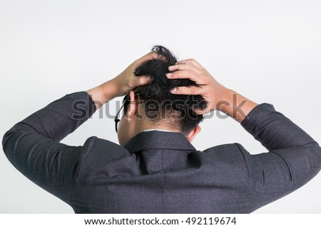 Stressed businessman touch his head . white isolated