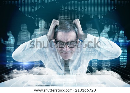 Stressed businessman using a keyboard against white silhouettes on black background - stock photo
