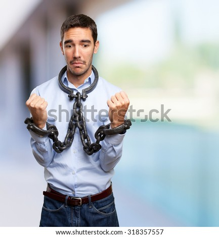 Stressed businessman with chained hands