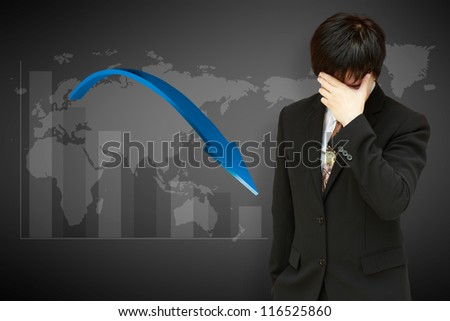 Stressed businessman with low financial graph of global business