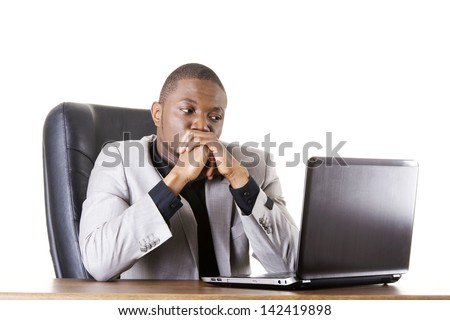 Stressed businessman working on laptop, isolated on white - stock photo