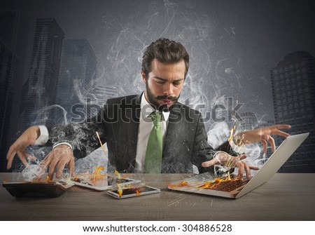 Stressed businessman working quickly with many computer
