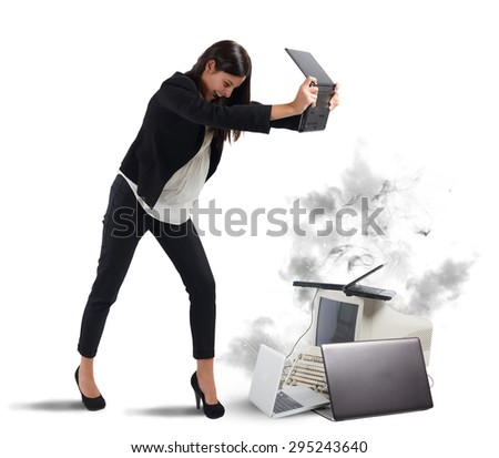 Stressed businesswoman furiously attacking computers and laptops - stock photo