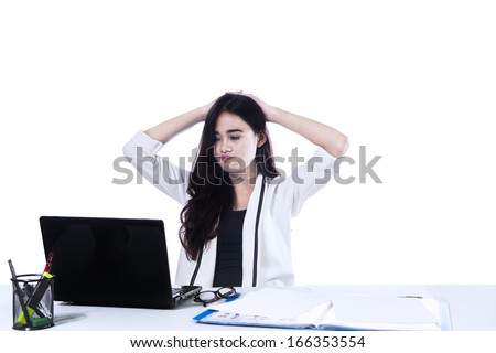 Stressed businesswoman is frustrated and overworked. Isolated on white background