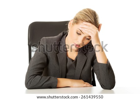 Stressed businesswoman tired of work
