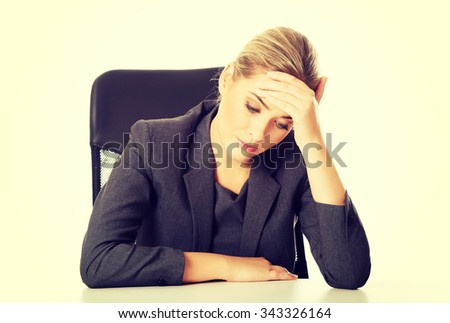 Stressed businesswoman tired of work - stock photo
