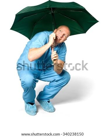 Stressed Caucasian man in uniform using umbrella - Isolated - stock photo